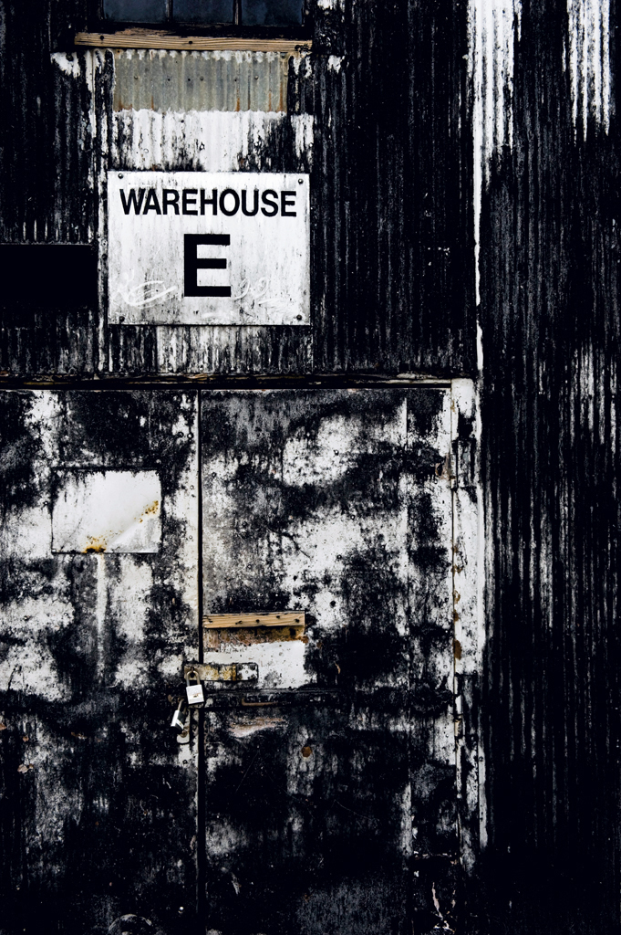 "The blackened walls of Warehouse E at Barton 1792 are a result of evaporating whiskey known as the ""angel's share"""