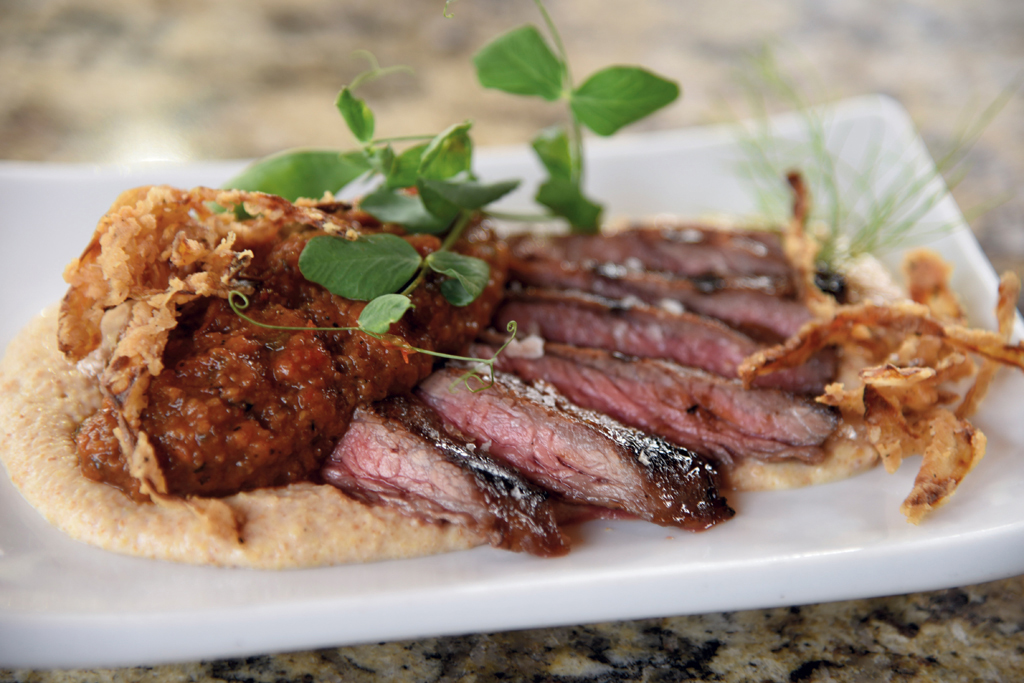 Bourbon flat iron steak with romesco and cornbread puree