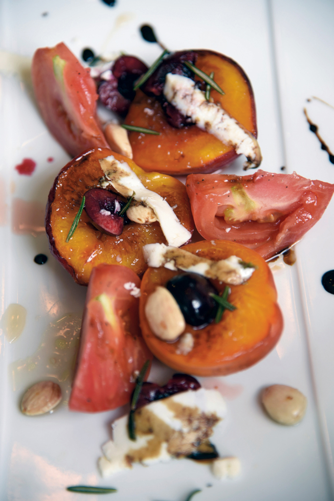 Roasted peaches with Bourbon-pickled cherries