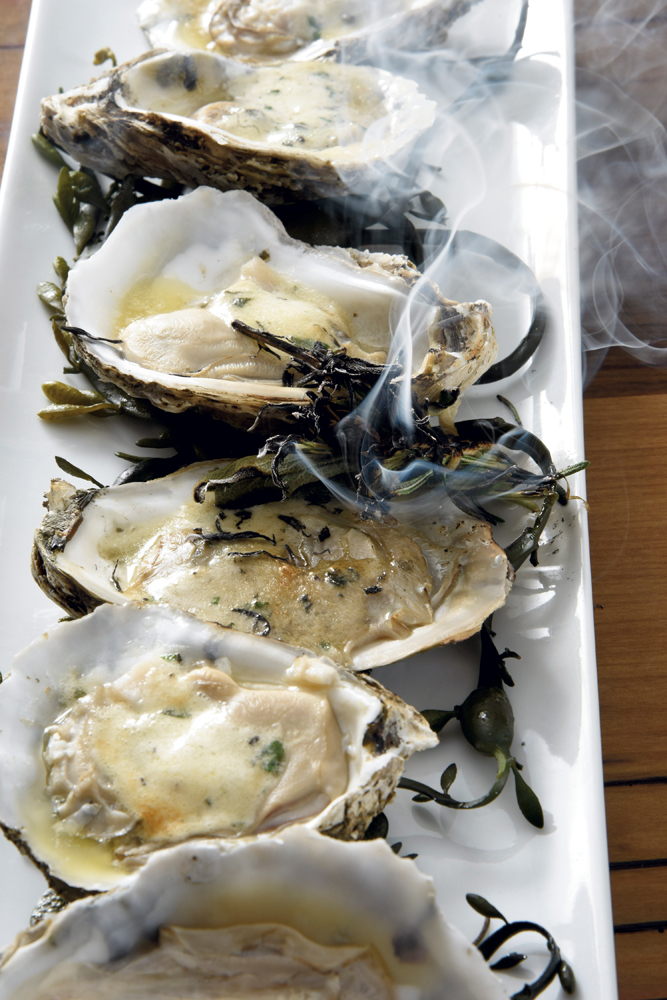 Grilled herb-roasted Chesapeake Bay oysters with garlic butter