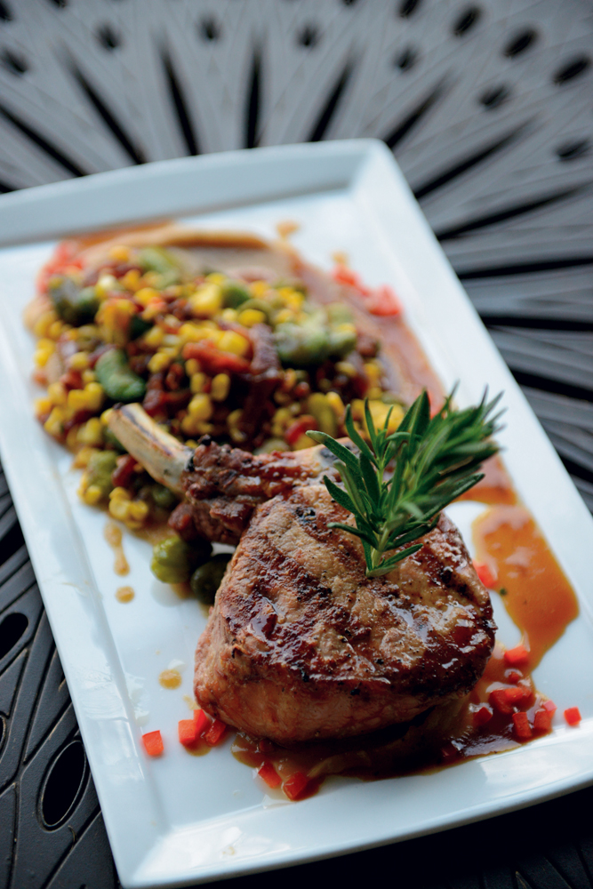 Pork chop with succotash, soubise and a Madeira wine demi.